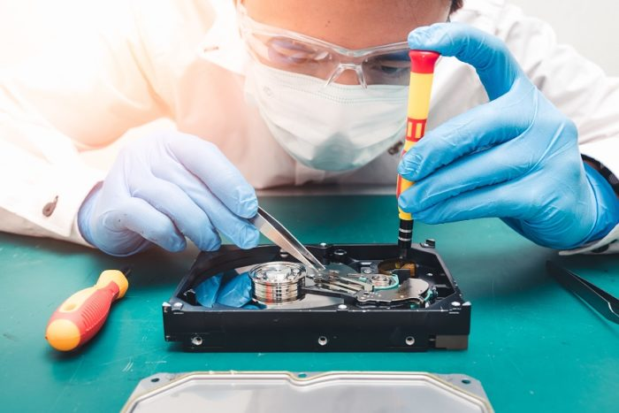 guy intensely recovering a hard drive